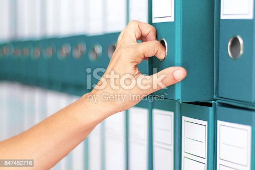 istock Businesswoman binders Female accountant archiving business documentation 847452716