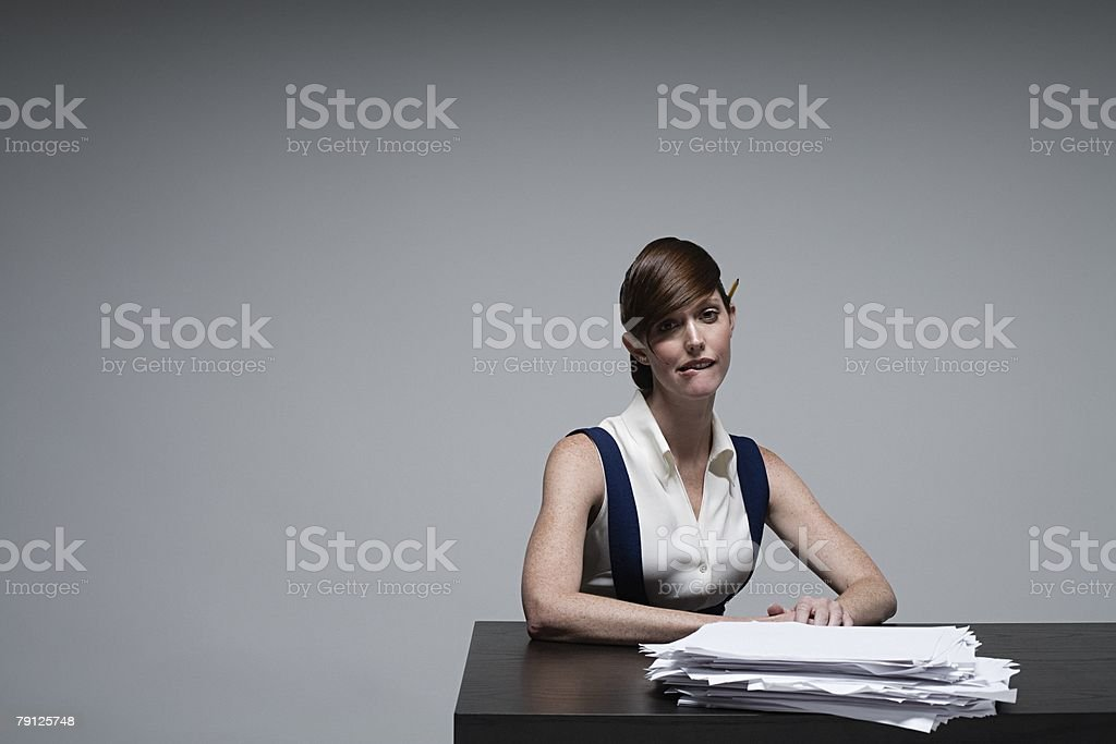 A businesswoman biting her lip royalty-free stock photo