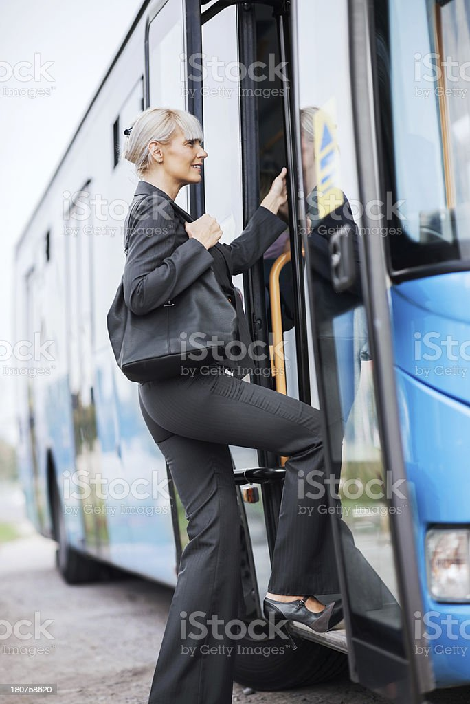 Businesswoman boarding a bus. stock photo
