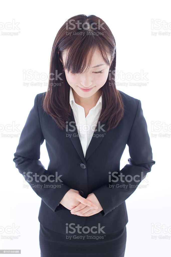 Businesswoman bowing stock photo