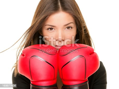 istock Businesswoman boxing gloves 153577636