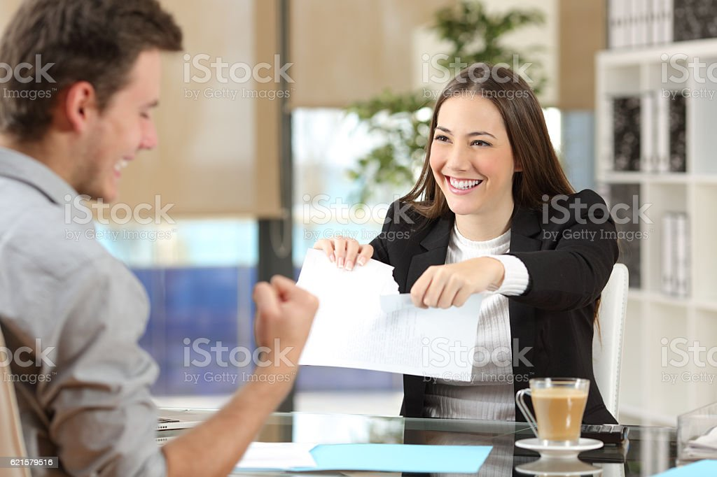 Businesswoman breaking contract with a client stock photo