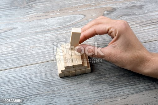 452592895 istock photo Businesswoman builds a tower 1206223954