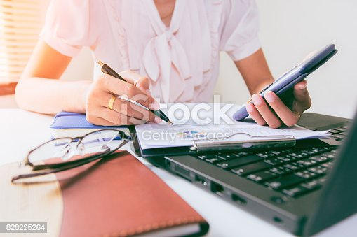 821678930 istock photo Businesswoman calculate about cost and doing finance at home office, Finance managers task,Concept business and finance investment 828225264