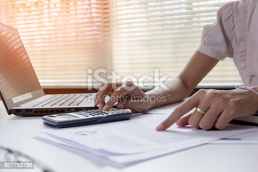 istock Businesswoman calculate about cost and doing finance at office, Finance managers task,Concept business and finance investment 827783786