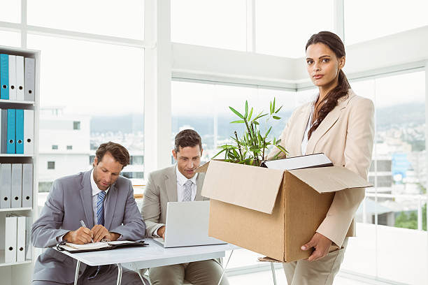 businesswoman carrying her belongings in box - leaving partnership corporate business sitting stock photos and pictures
