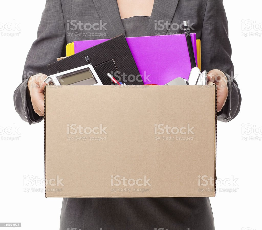 Businesswoman Carrying Office Items stock photo
