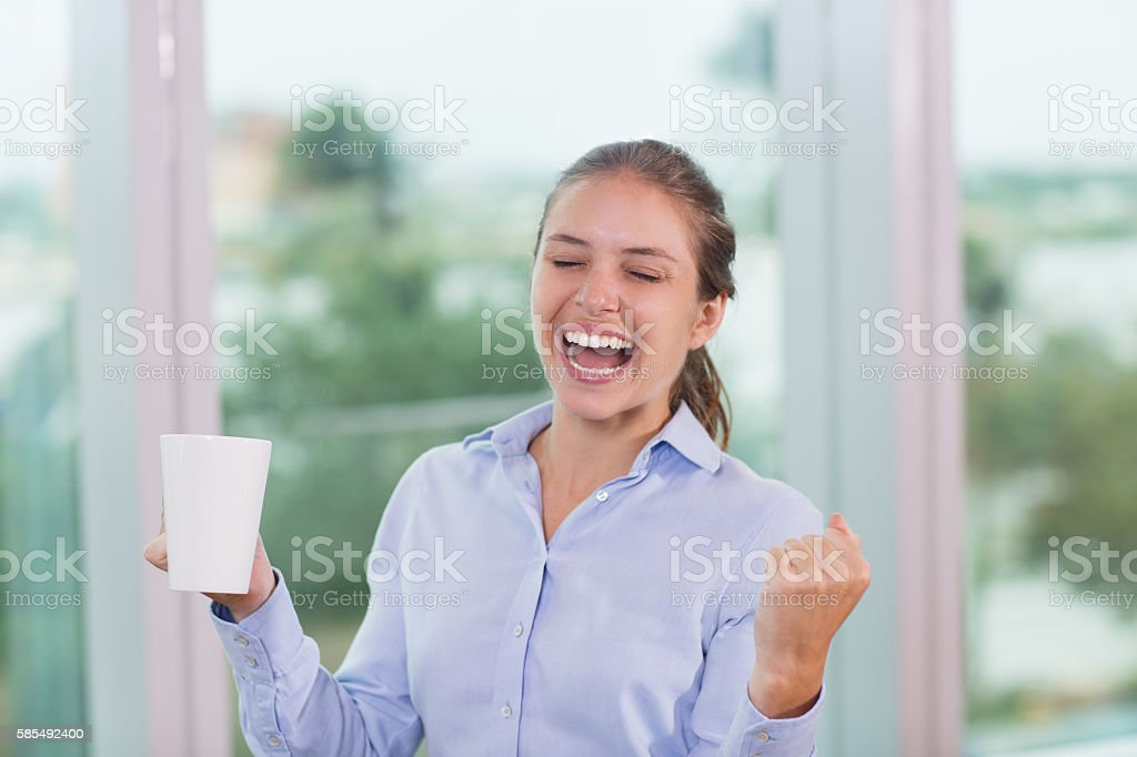 Businesswoman Celebrating in Office 1 stock photo