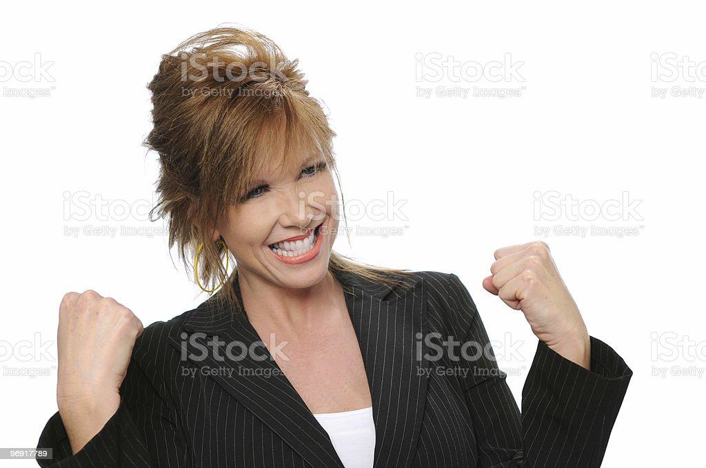 Businesswoman celebrating royalty-free stock photo