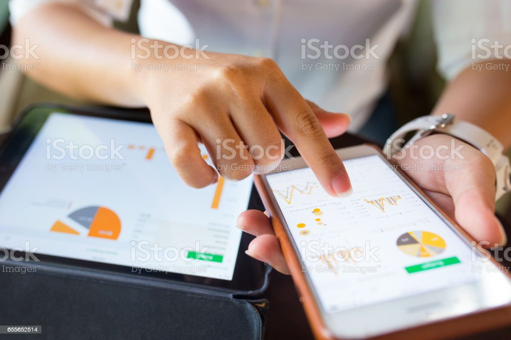 Businesswoman check data in smartphone and tablet royalty-free stock photo