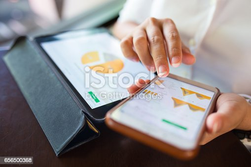 istock Businesswoman check data in smartphone and tablet 656500368