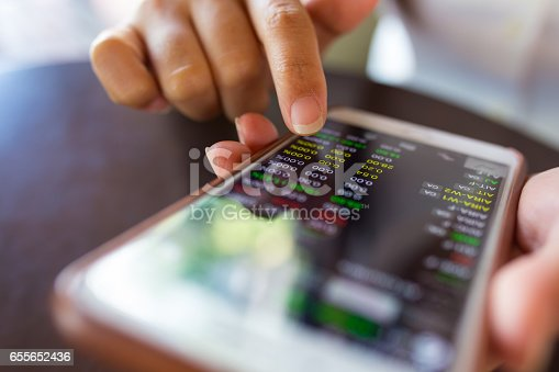 istock Businesswoman check data in smartphone 655652436