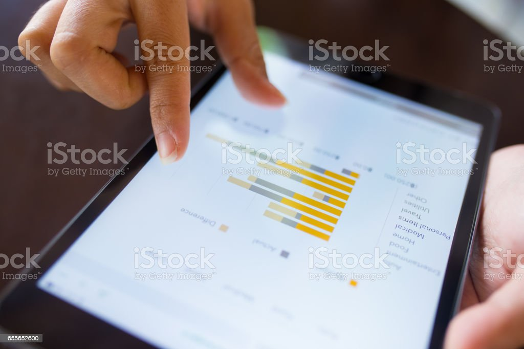 Businesswoman check data in tablet stock photo