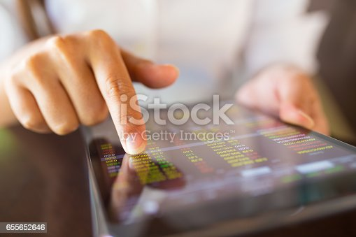 istock Businesswoman check data in tablet 655652646