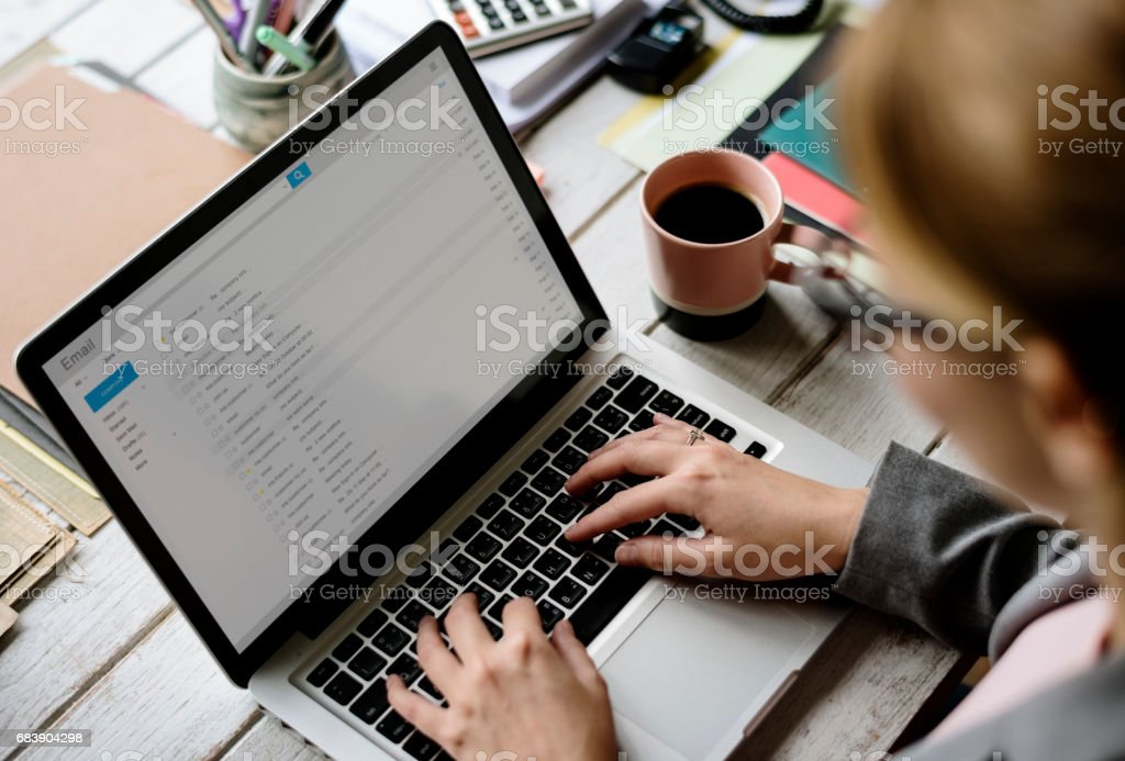 Businesswoman Checking E-mail Online on Laptop stock photo