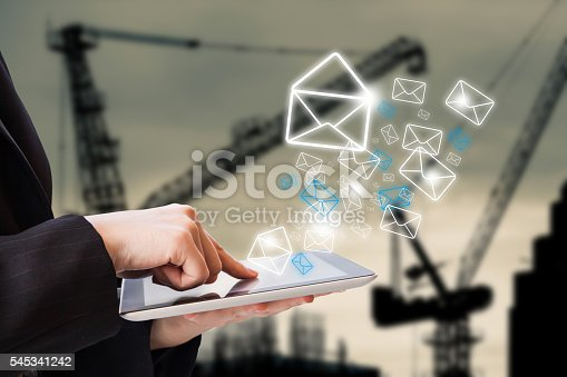 545576042 istock photo Businesswoman checking email 545341242
