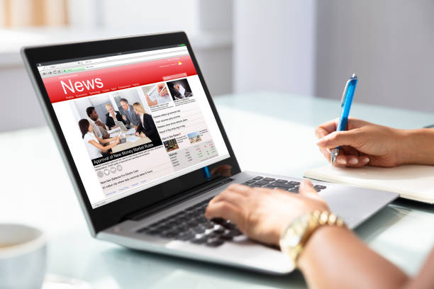 Businesswoman Checking Online News On Laptop stock photo