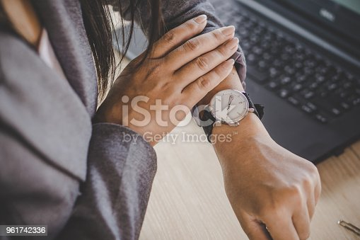 istock businesswoman checking the time on watch 961742336
