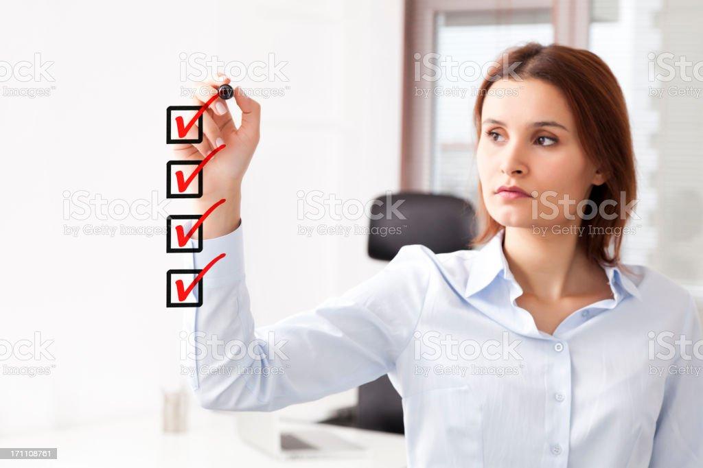 Businesswoman checklist royalty-free stock photo