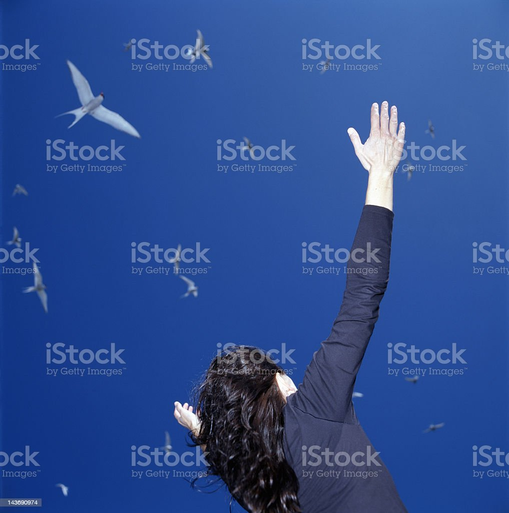 Businesswoman cheering outdoors stock photo