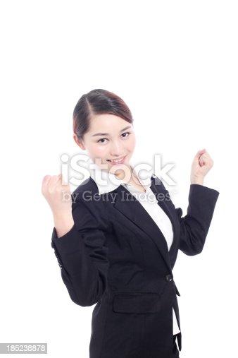 500150419istockphoto Businesswoman cheering 185238878