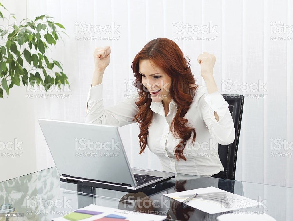 Businesswoman Cheering With Her Arms in the Air. royalty-free stock photo