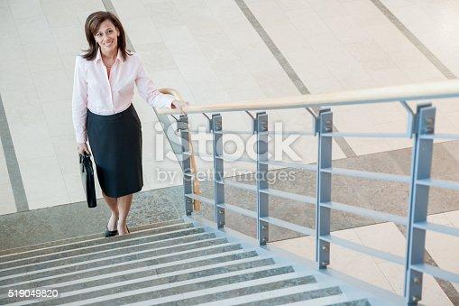 istock Businesswoman climbing a stairway 519049820
