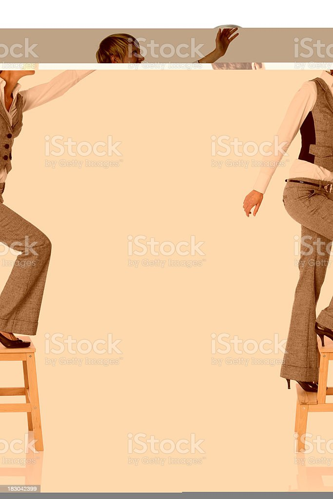 Businesswoman climbing a step stool royalty-free stock photo