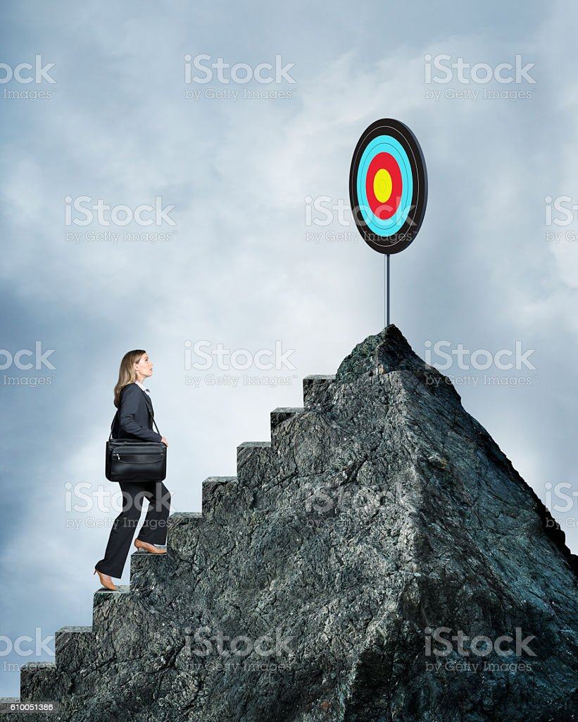 businesswoman climbing steps to reach her goal stock photo more