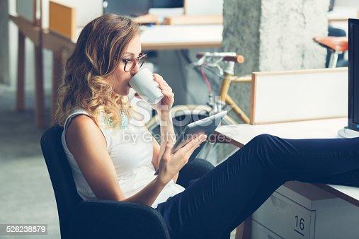 istock Businesswoman coffee break in office. 526238879