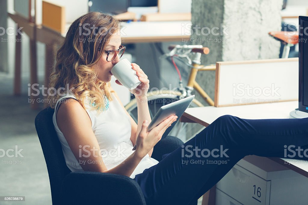 Businesswoman coffee break in office. stock photo