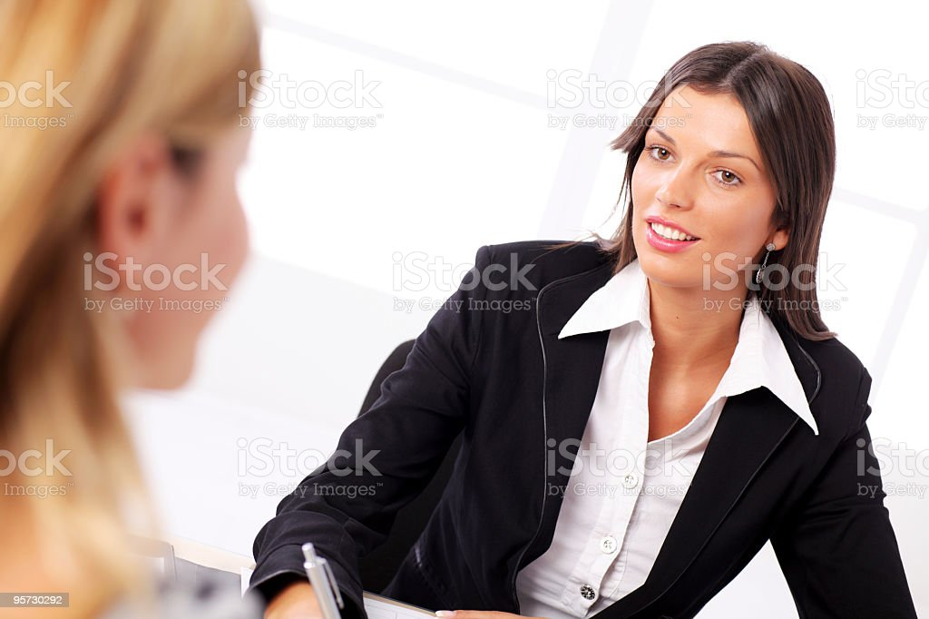 Businesswoman conducting job interview in brightly office royalty-free stock photo