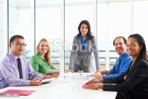 istock Businesswoman Conducting Meeting In Boardroom 178607983