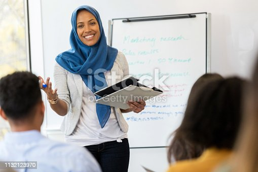 istock Businesswoman conducts employee training class 1132123970