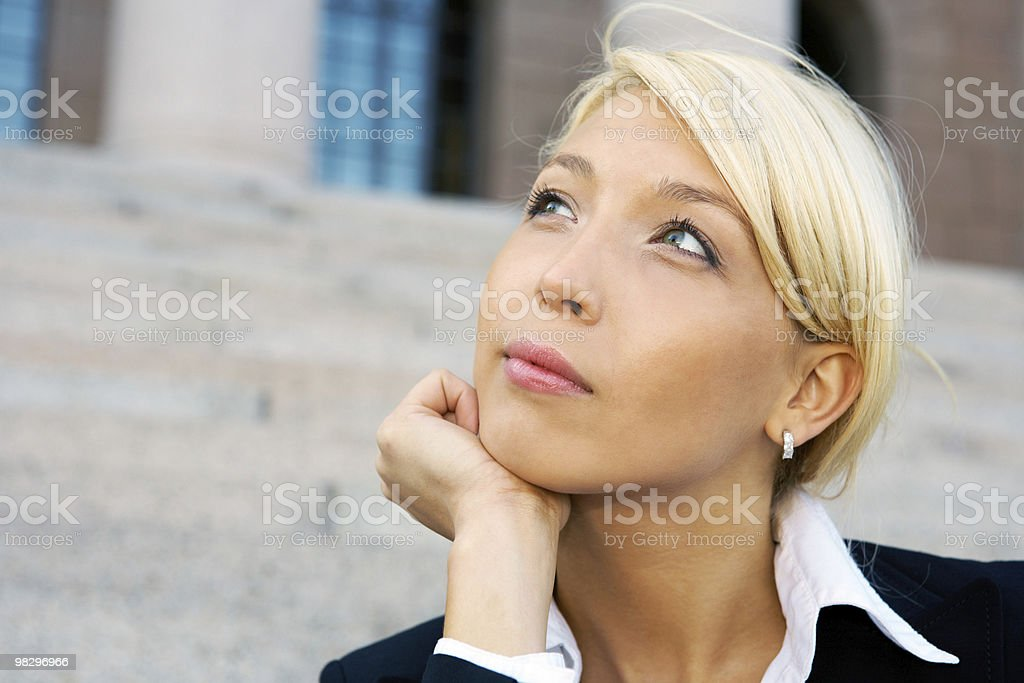 Businesswoman contemplating royalty-free stock photo