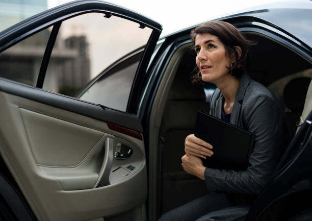 businesswoman corporate taxi transport service - limousine service stock photos and pictures