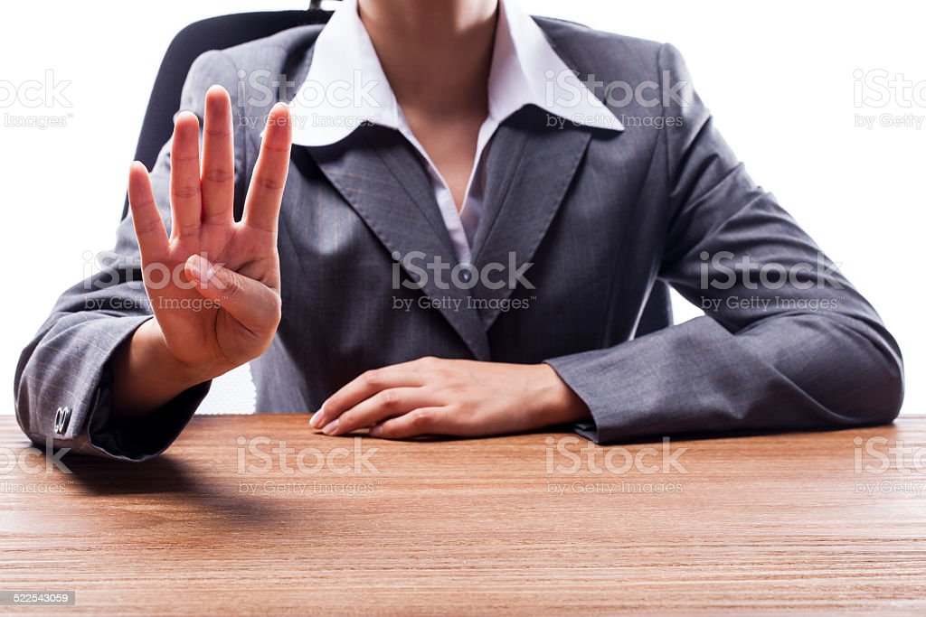 Businesswoman Counting Four stock photo