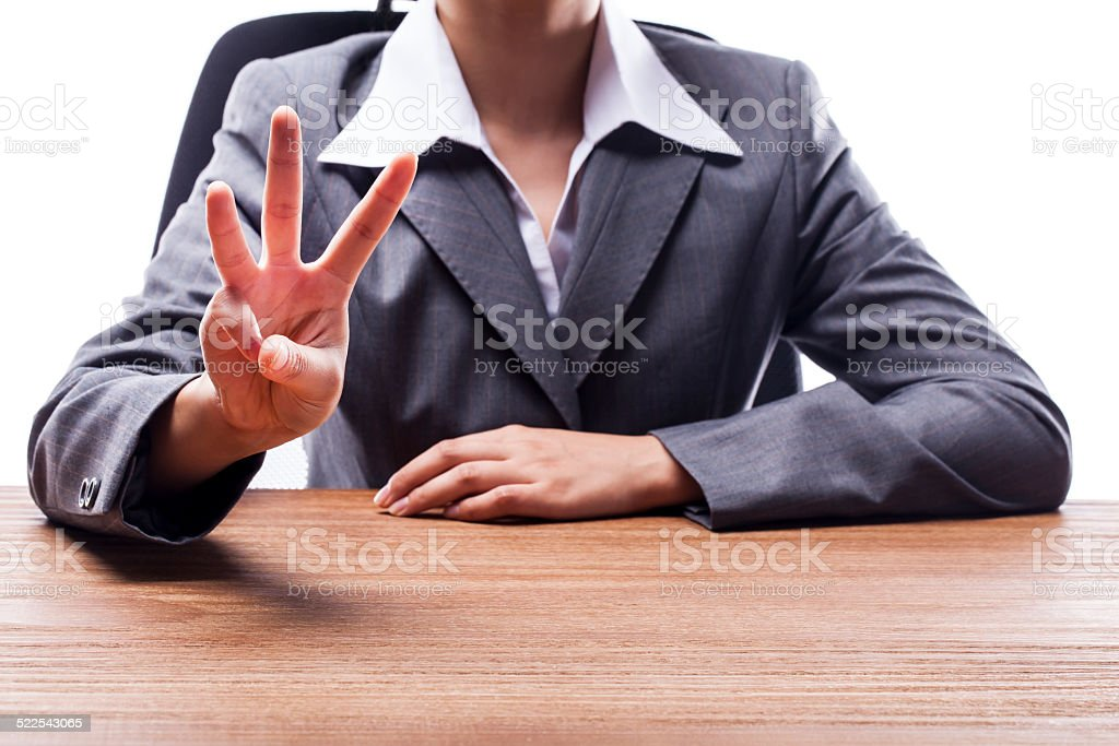 Businesswoman Counting Three stock photo
