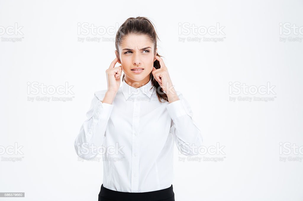 Businesswoman covering her ears with hands isolated stock photo