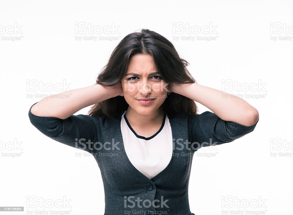 Businesswoman covering her ears with hands stock photo