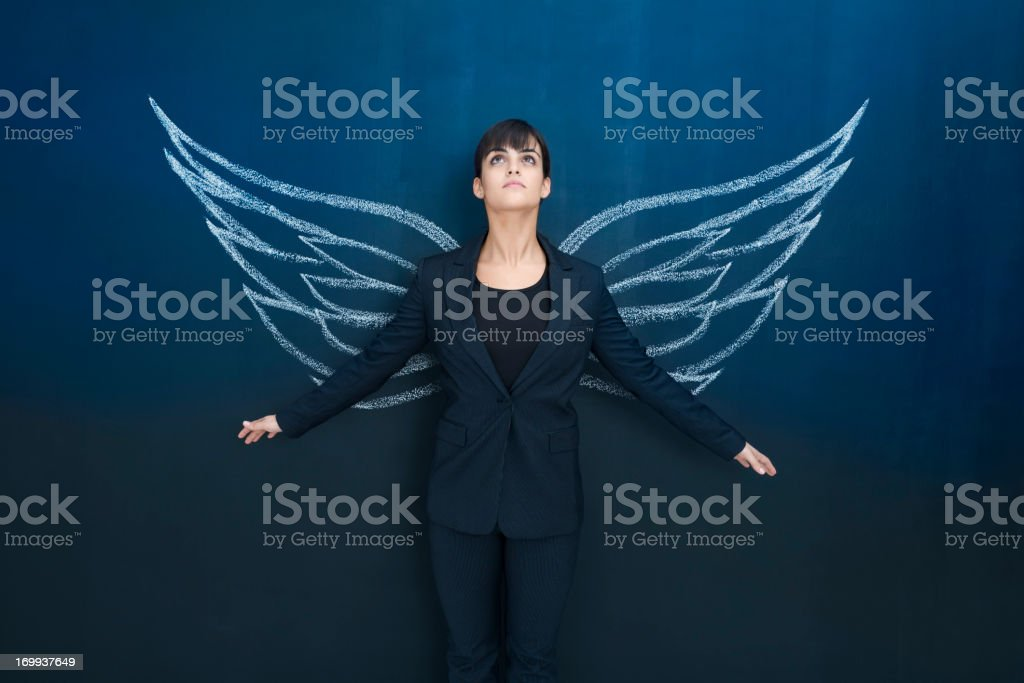 Businesswoman day dreaming stock photo