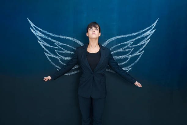businesswoman day dreaming - animal wing stock photos and pictures