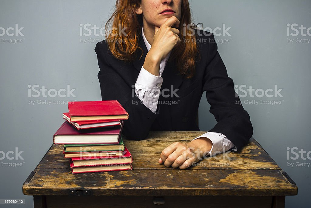 Businesswoman deep in thought royalty-free stock photo