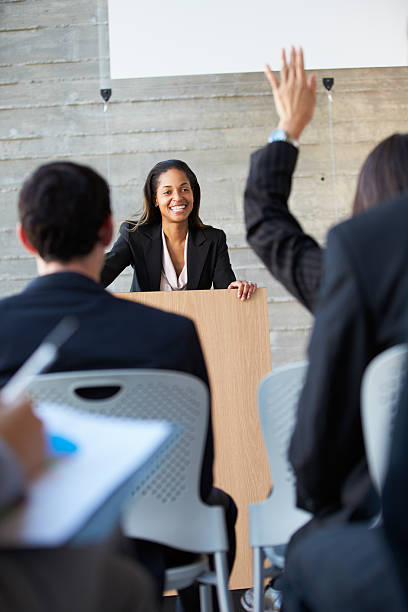 Businesswoman delivering a conference presentation stock photo