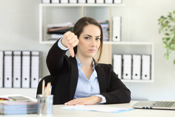 businesswoman denying with thumbs down - thumbs down stock photos and pictures