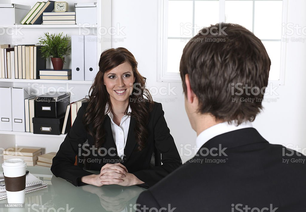 Businesswoman discussing with a businessman in office royalty-free stock photo