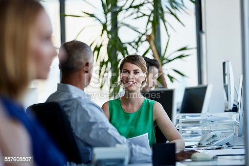 557608497istockphoto Businesswoman discussing with colleague in office 557608507