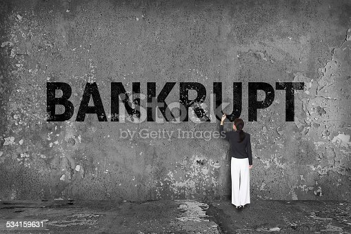 istock businesswoman drawing bankrupt on wall 534159631