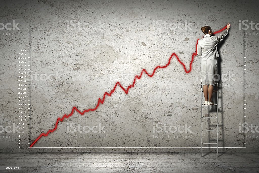 businesswoman drawing diagrams on wall royalty-free stock photo