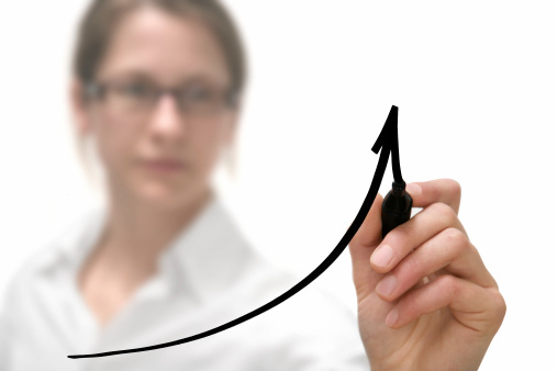Businesswoman Drawing Graph Stock Photo - Download Image Now